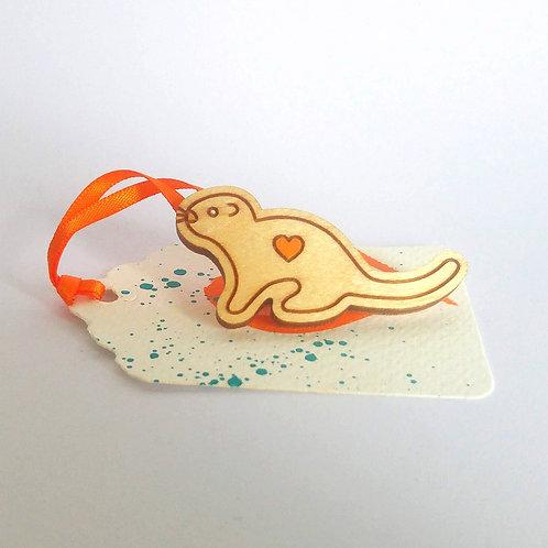 Wooden otter brooch