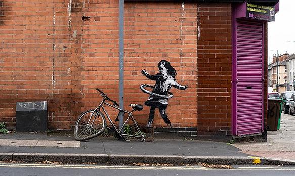 Banksy girl with tyre.jpeg