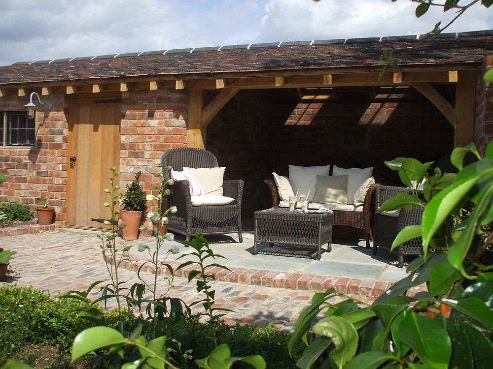 Reclaimed bricks, paving, beams and tiles used in a courtyard garden