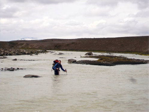 walking through rivers in iceland