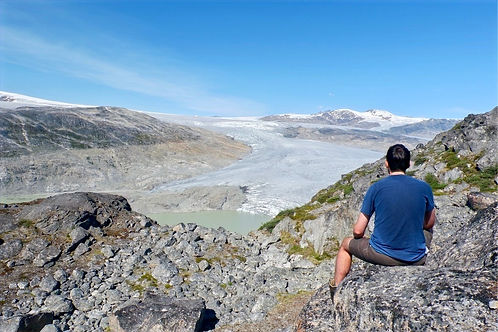 person looking out over a glacier