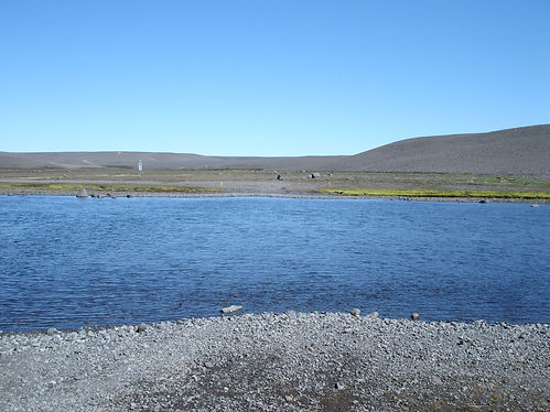 wading a glacial river in iceland