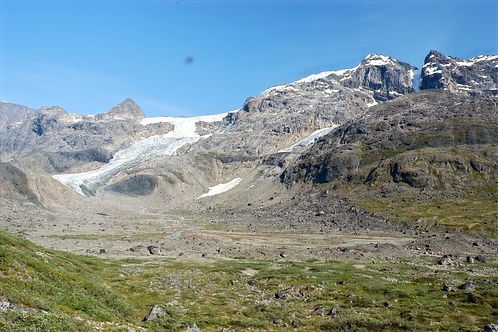 hiking among glaciers in greenland
