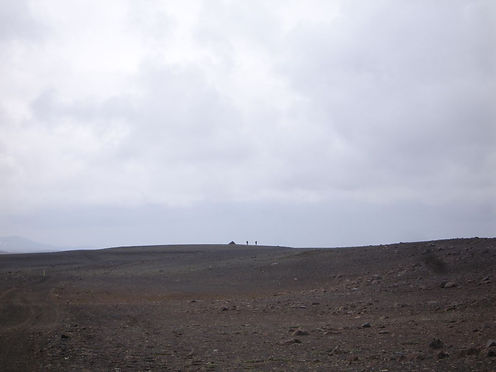 Hikers on a distant mountain ridge