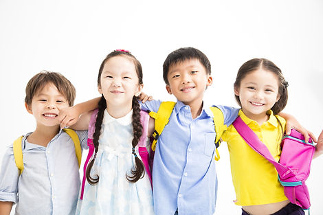 Group of happy smiling kids standing tog