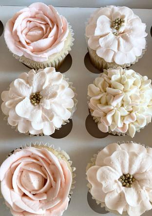 Flower cupcakes.  Starts at $36 per dozen