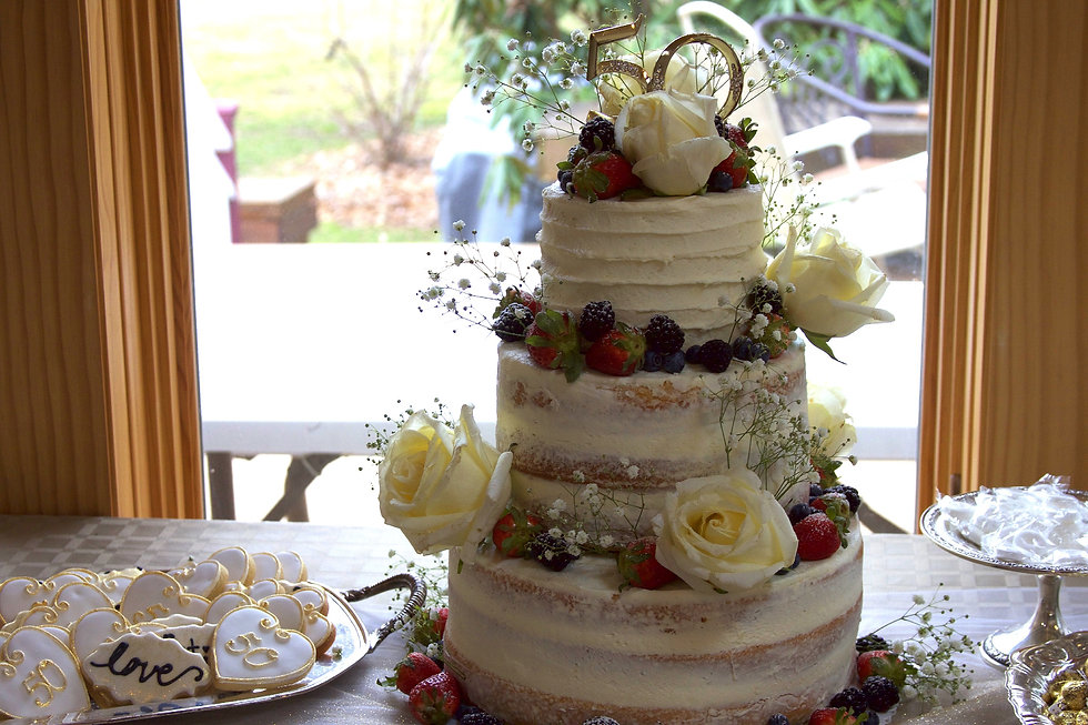 Three Tier Semi-Naked 50th Anniversary Cake with Fresh Fruit and White Roses