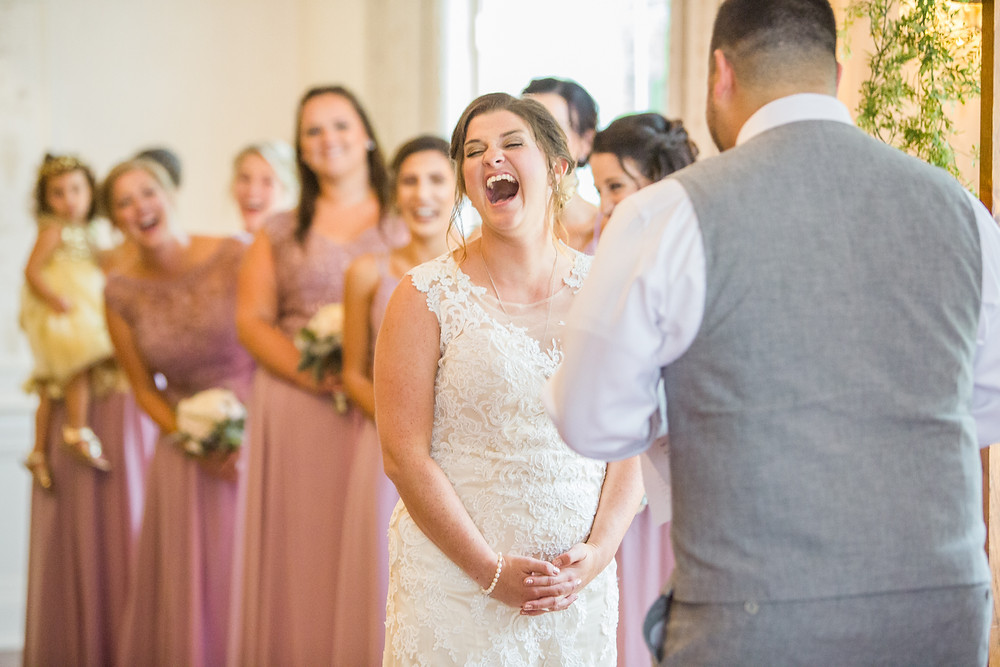 bride laughing at vows