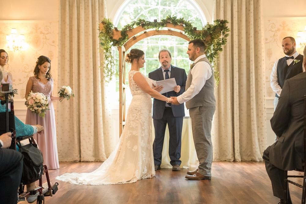 bride and groom at wedding alter colonial hotel gardner