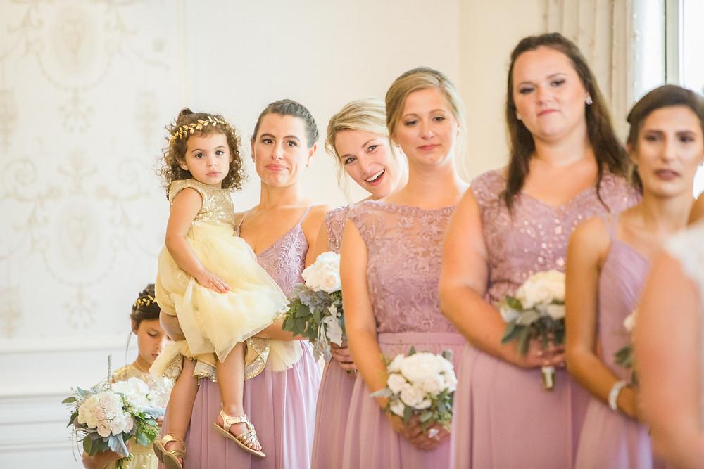 bridesmaids purple dresses wedding ceremony