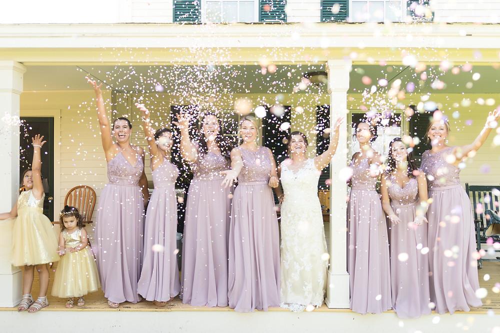 bridesmaids throwing confetti wedding photo