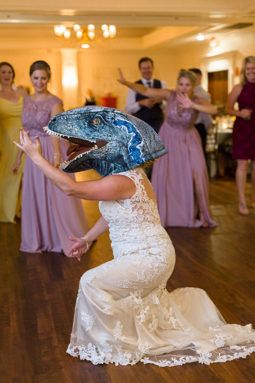 bride dancing in dinosaur mask
