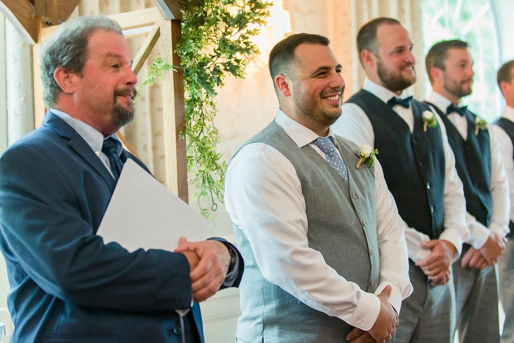 groom seeing bride walk down the aisle