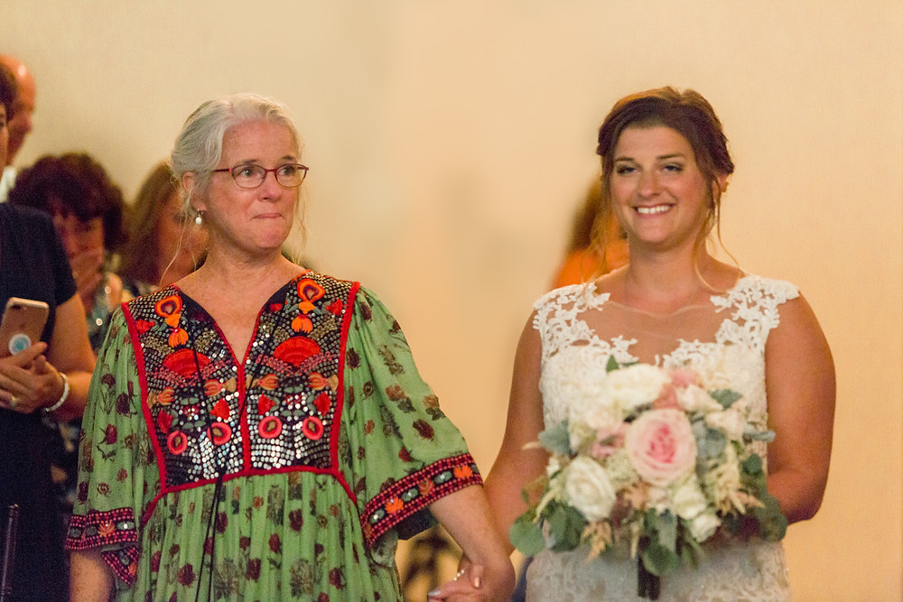 mother daughter bride walking down the aisle