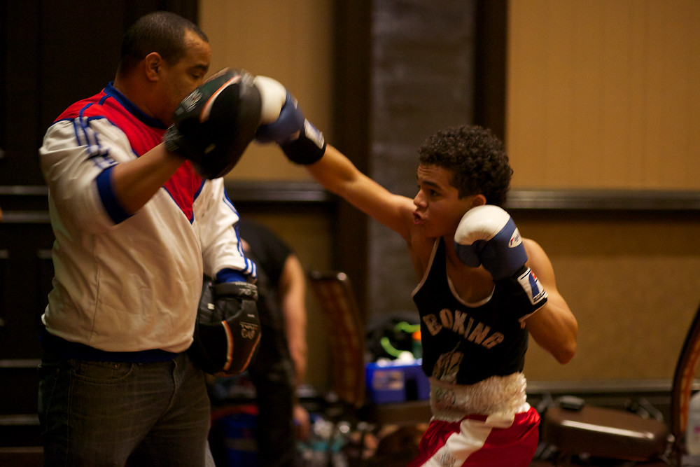 Eli warming up with his dad/coach Percy Pride before his bout