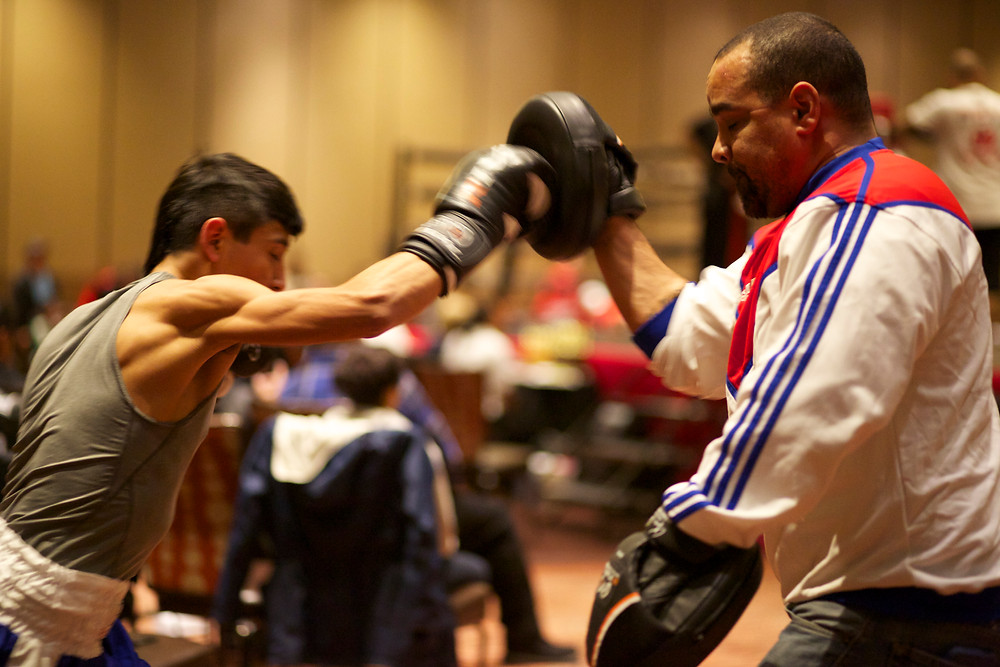 Joe Rivas warming up with Coach Pride moments before his bout
