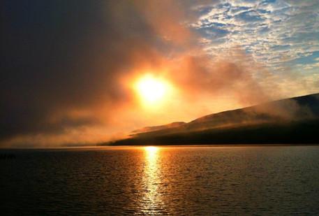 Sun burning through fog