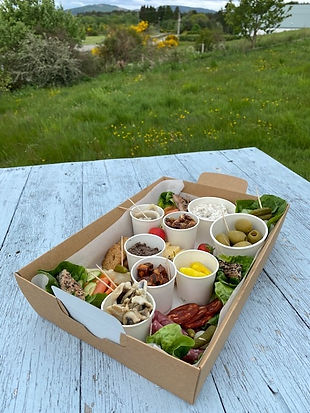 Sharing takeaway box on blue table at buchanan bistro restaurant