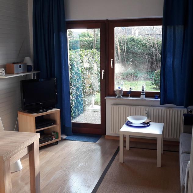 Das Wohnzimmer mit Essecke