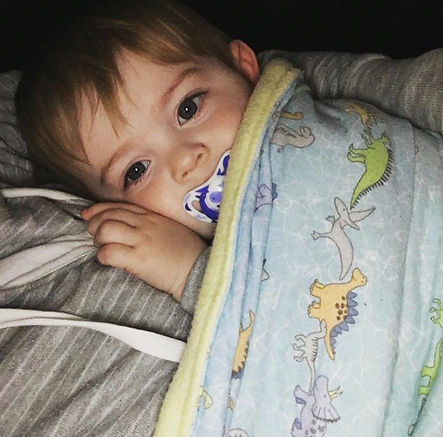 Baby Dominic with his teddy bear blanket