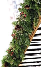 Mantelpiece evergreen expert decorated