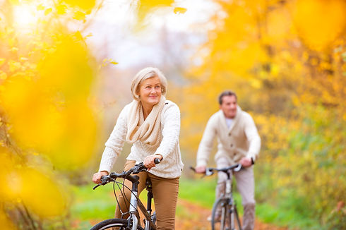graphicstock-active-seniors-riding-bikes-in-autumn-nature-they-having-romantic-time-outdoor_S0NMVN6Z