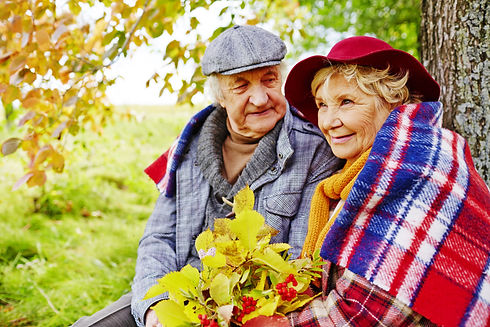 graphicstock-affectionate-senior-couple-having-rest-under-tree-on-autumn-day_BQxcBt8GVb.jpg