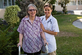 doctor-assisting-woman-in-walking-at-bac