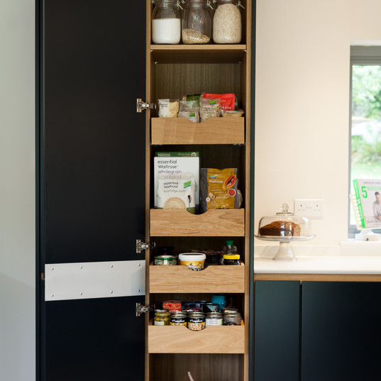The larder cupboard has 5 solid oak pull out drawers