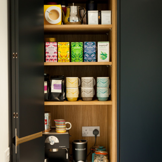 The bi-fold door pantry is perfect for hiding away tea and coffee