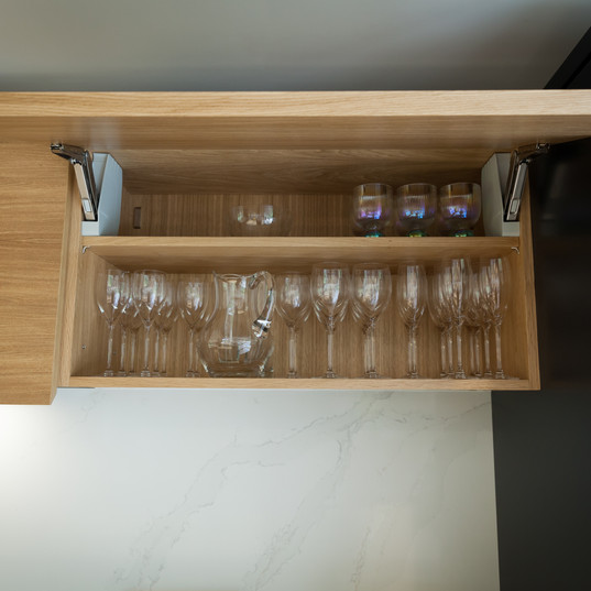 There's plenty of glassware storage in these lift-up wall units