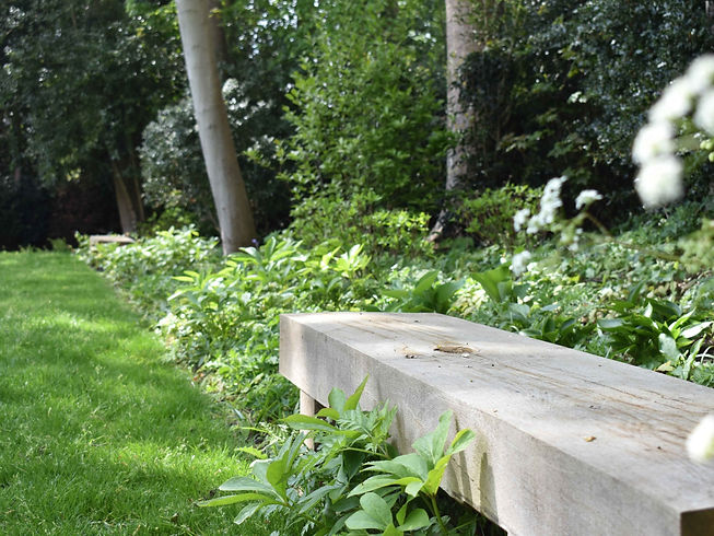 French oak bench in planting Studio Cullis garden