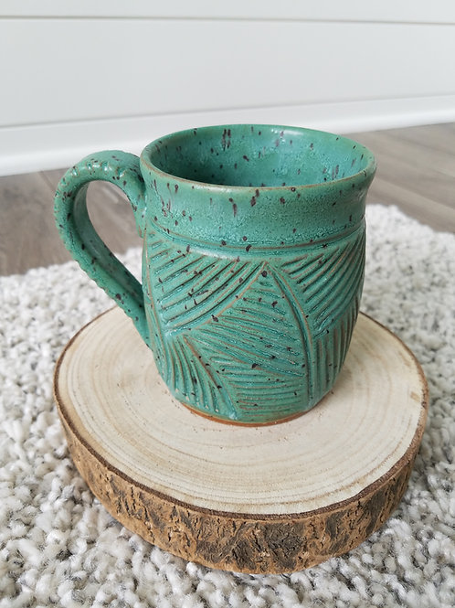 Satin patina carved mug