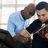 Teacher Helping Student Playing Violin