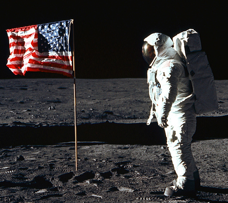 An astronaut stands on the moon.