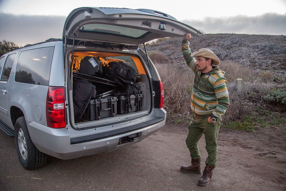 David Ruck with film equipment loaded into a Chevy Suburban in California.