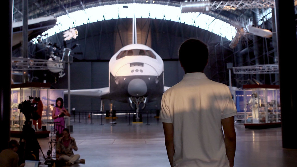 Blair fawns over the space shuttle at the Air and Space Museum.