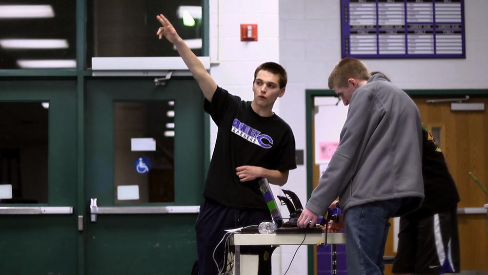 Blair leading his robotics team.
