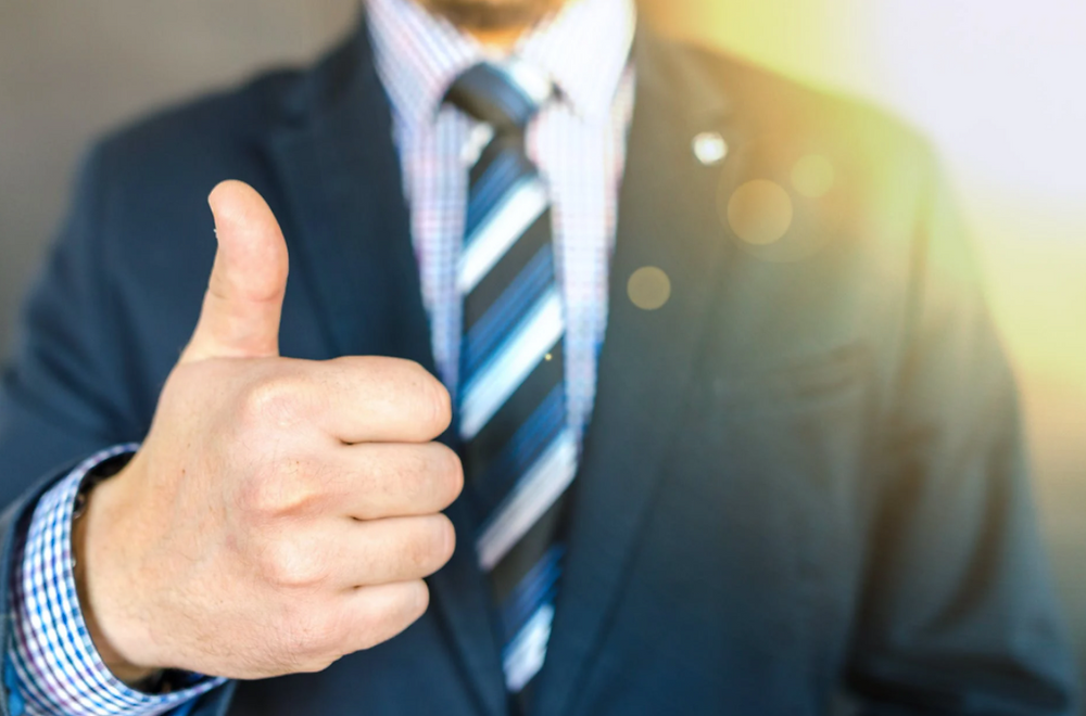 Man In Suit With Thumbs Up