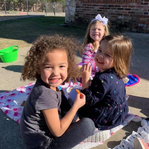 Children playing outside and having snacks at preschool