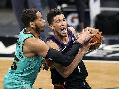 Booker leads Suns to O/T win