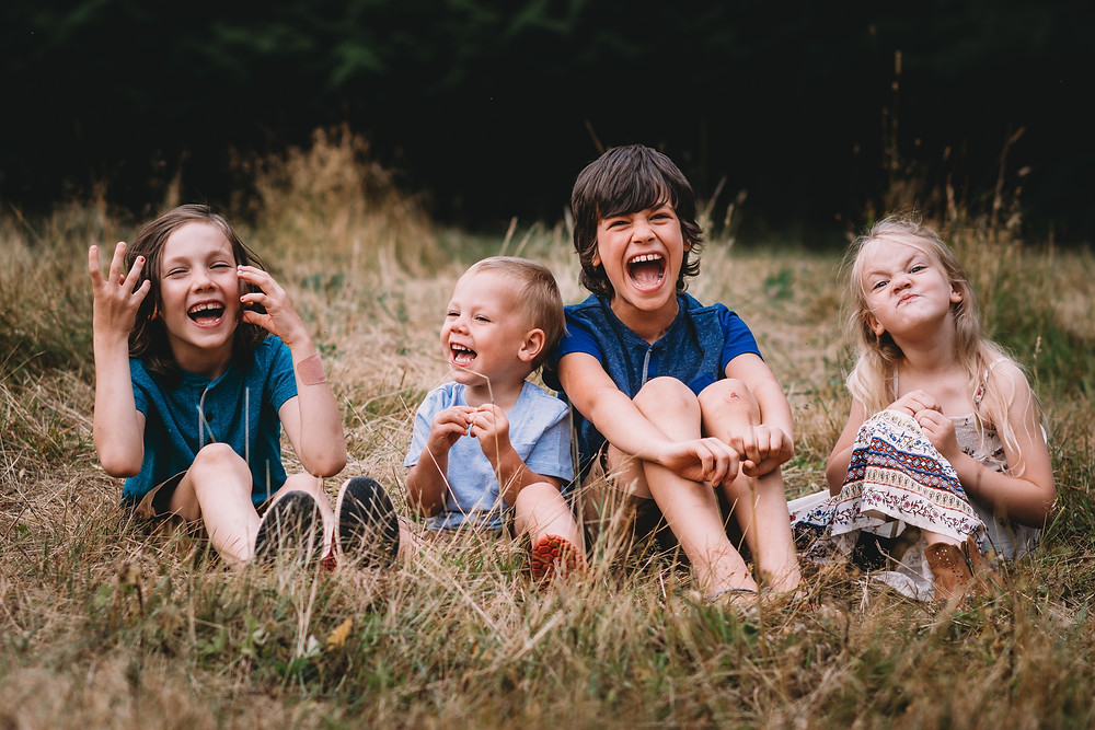 Kids laughing in a field