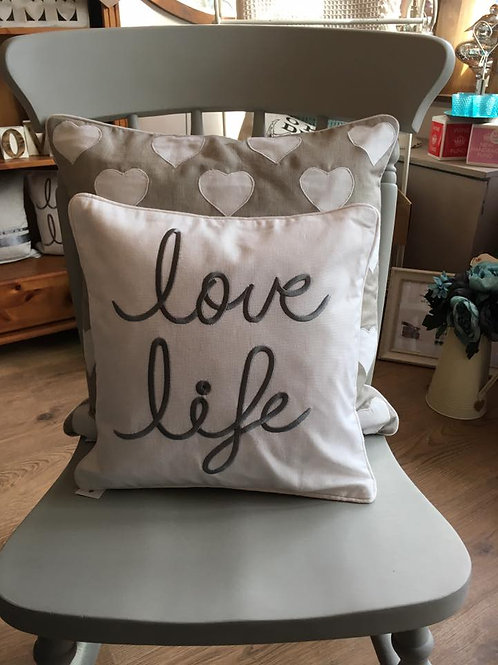 white cotton 'love life' cushion