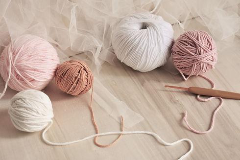 Woolen ball Crochet background Pink Pastel theme White chiffon Wood background Crochet hoo