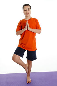 Boy Doing Yoga Pose in a Studio.jpg