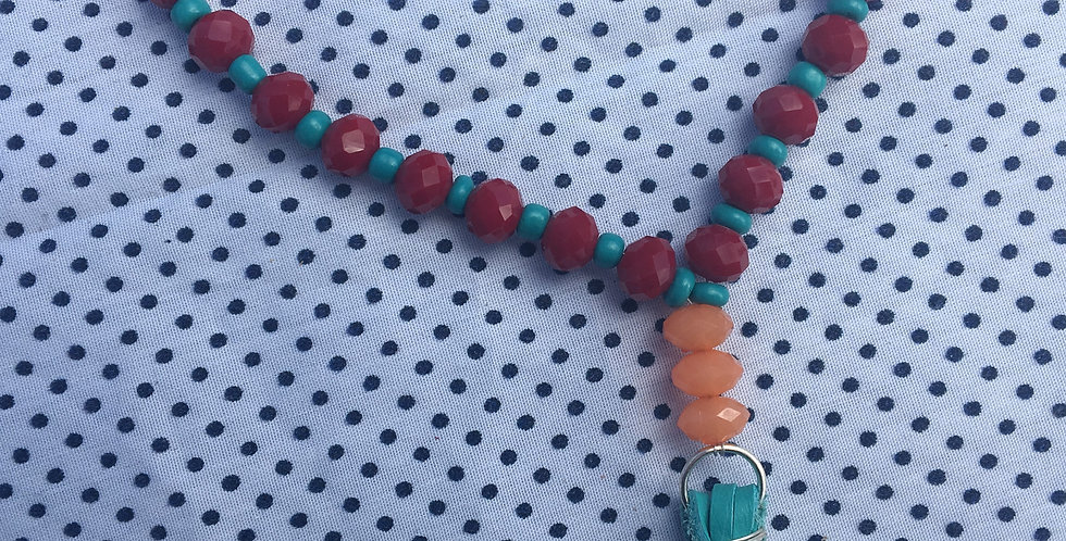 Turquoise and red tassel