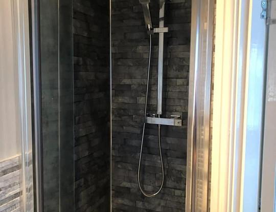 Shower enclosure as part of a refit