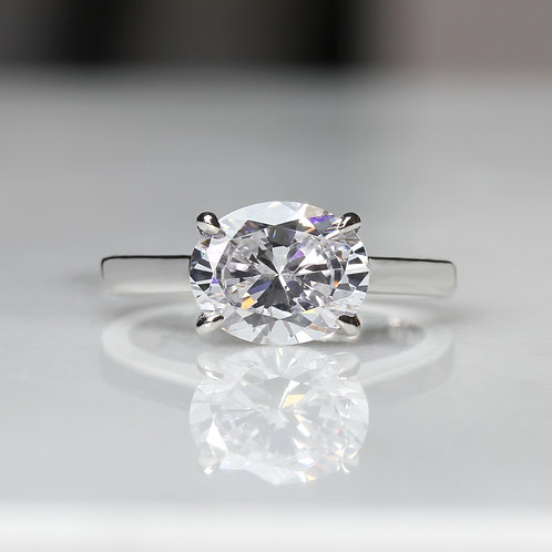 Sterling Silver Diamond Simulant Oval Cut Solitaire East West Engagement Ring