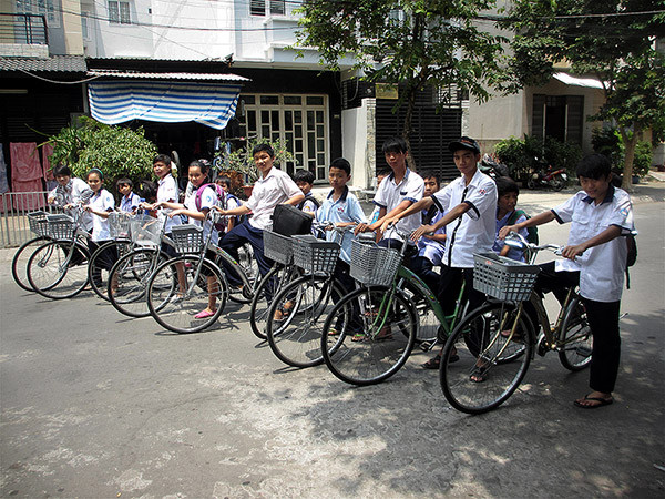 """They Went Bananas"" -- Vietnamese Orphans Get New Bikes For School"