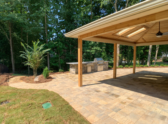 Pine pergola with shingle roof and tongue and groove ceiling